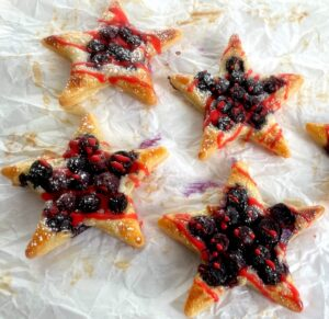 puff pastry stars with blueberries and red icing