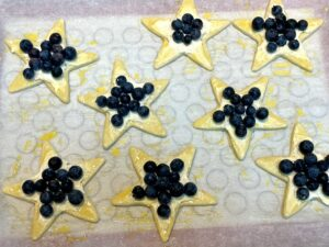 puff pastry stars with cream cheese, blueberries and egg wash