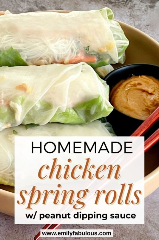 chicken spring rolls in a bowl with peanut dipping sauce