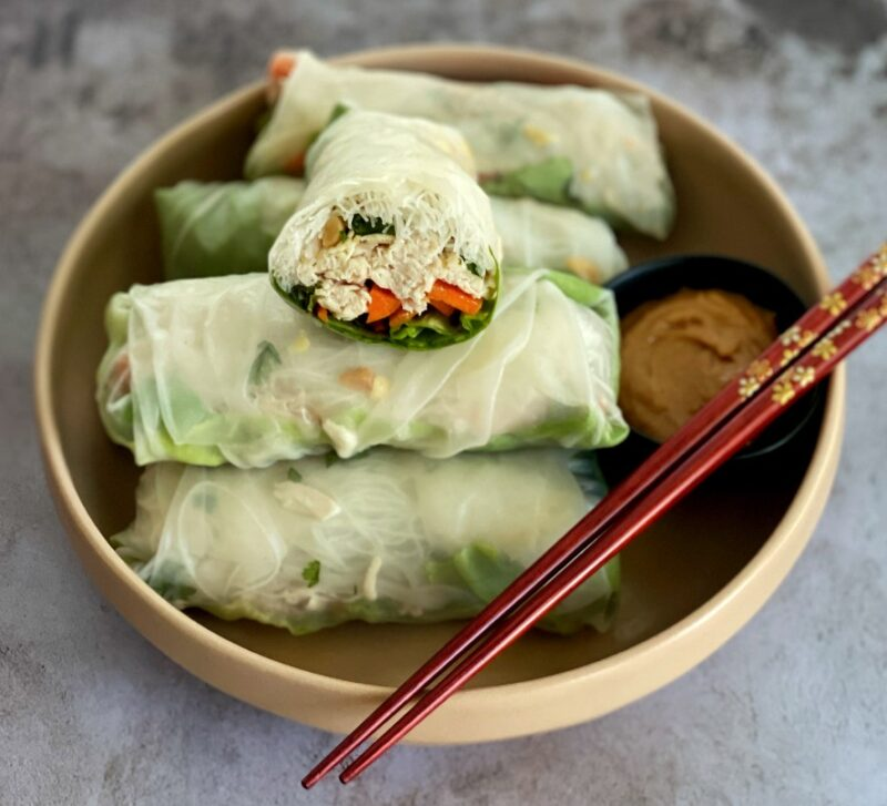 spring rolls on a plate with peanut sauce