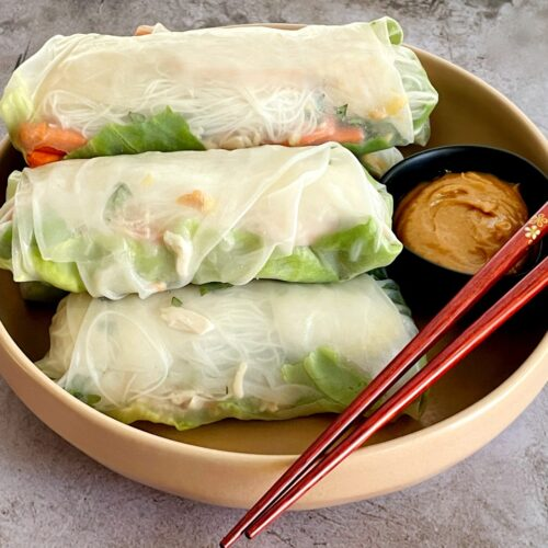 spring rolls with peanut sauce on a plate