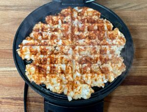 tater tots cooked in a waffle maker