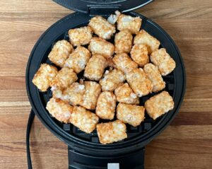 tater tots in a waffle iron