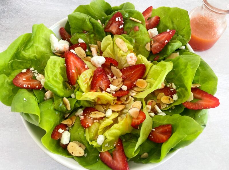 butter lettuce salad with strawberry vinaigrette, almonds and feta cheese
