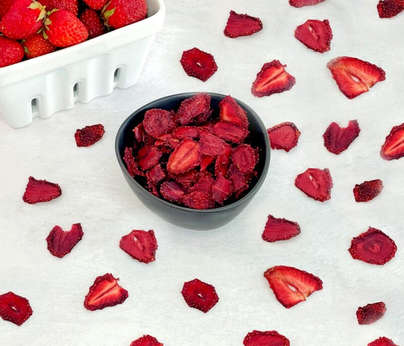 dehydrated strawberries in a bowl and on a table