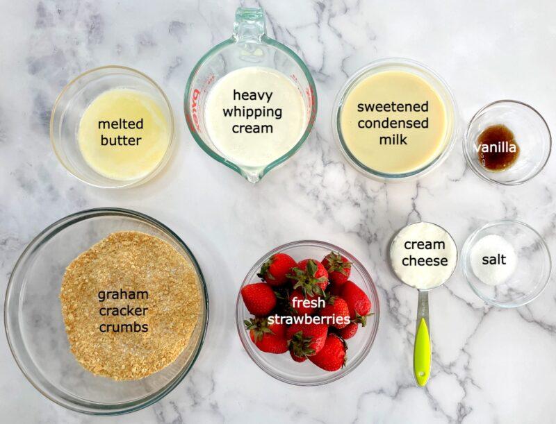 ingredients for strawberry cheesecake ice cream pie: butter, cream, condensed milk, vanilla, salt, cream cheese, strawberries, graham crackers