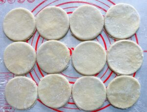 pie crust rounds on a floured surface