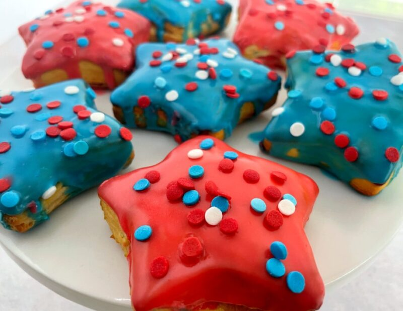 star donuts with red and blue icing and sprinkles