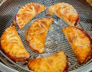 strawberry turnovers in an air fryer basket