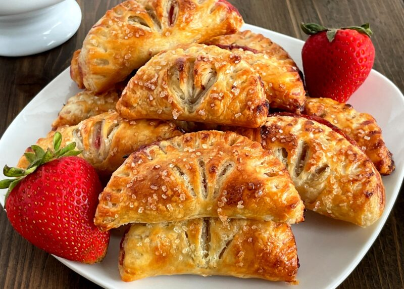 a pile of strawberry turnovers on a plate