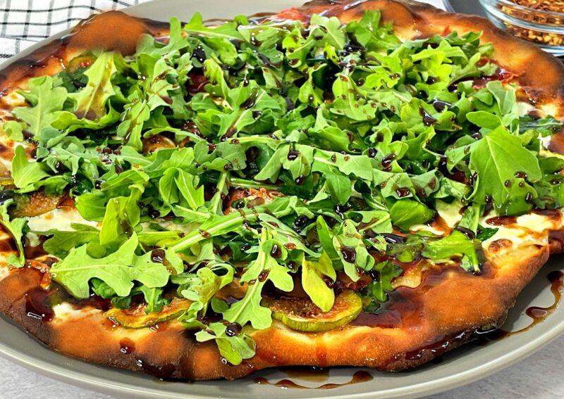 fig prosciutto pizza with arugula and balsamic glaze