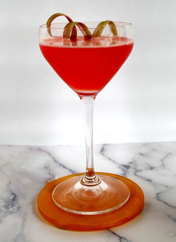 a strawberry rhubarb cocktail with rhubarb garnish
