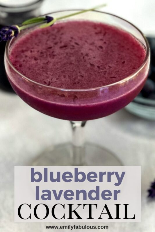 blueberry lavender cocktail with fresh lavender sprig garnish