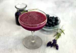 blueberry lavender cocktail with blueberries, lavender and syrup