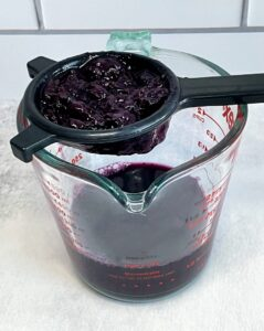blueberry lavender syrup being strained