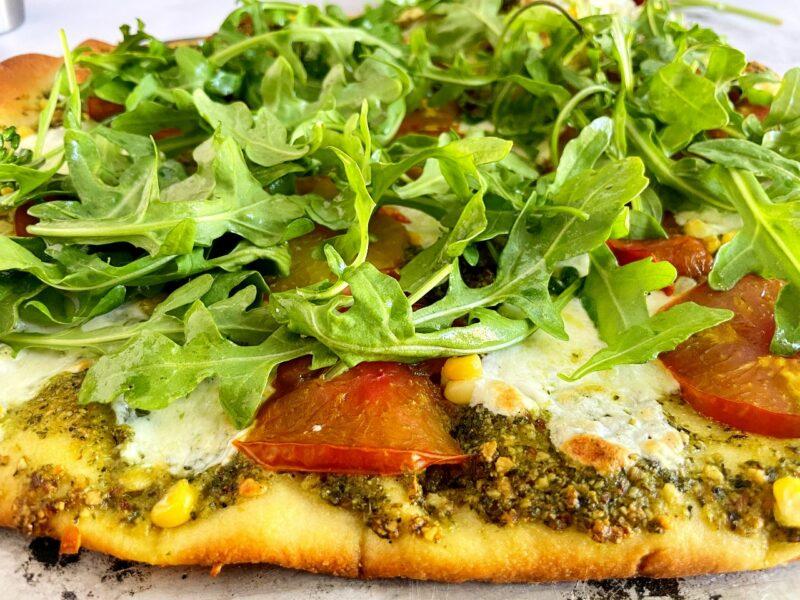 heirloom tomato, corn and arugula pizza