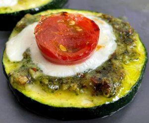 pesto zucchini bite with mozzarella and tomato