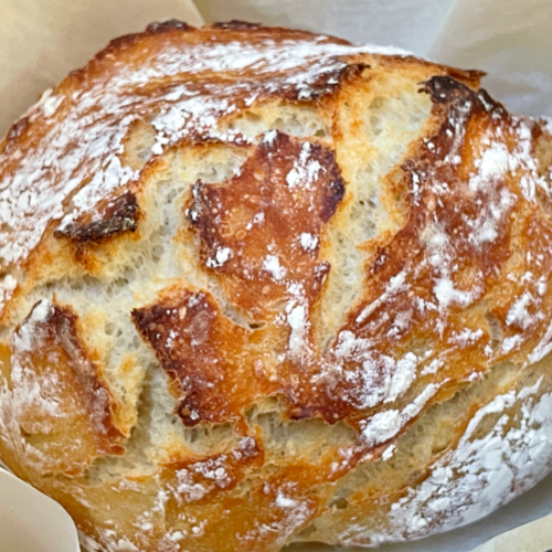 baked no-knead sourdough bread in a dutch oven