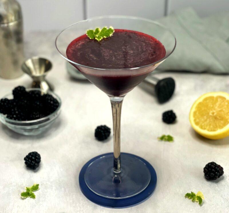 blackberry martini with a fresh mint garnish