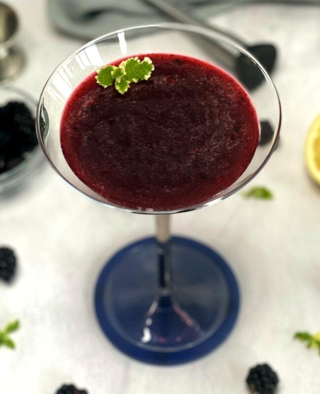 blackberry martini in a martini glass