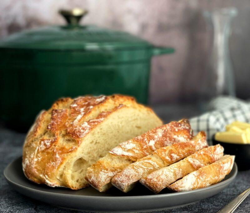 dutch oven sourdough bread sliced on a plate