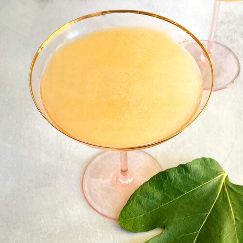 fig syrup cocktail in a coupe glass