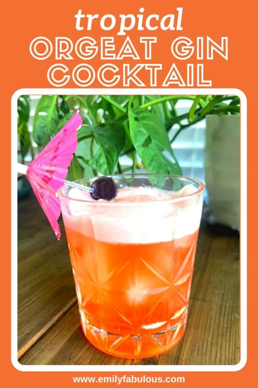 gin tiki cocktail with a cherry garnish