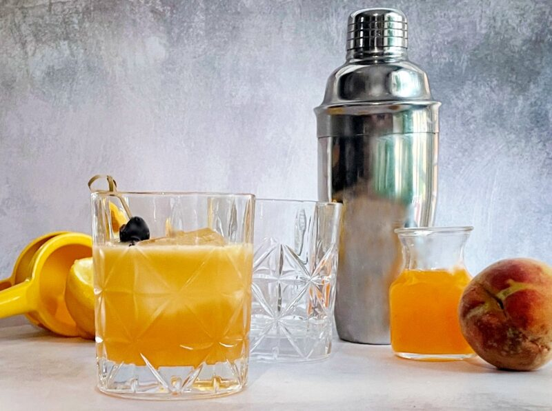 peach whiskey sour and peach syrup