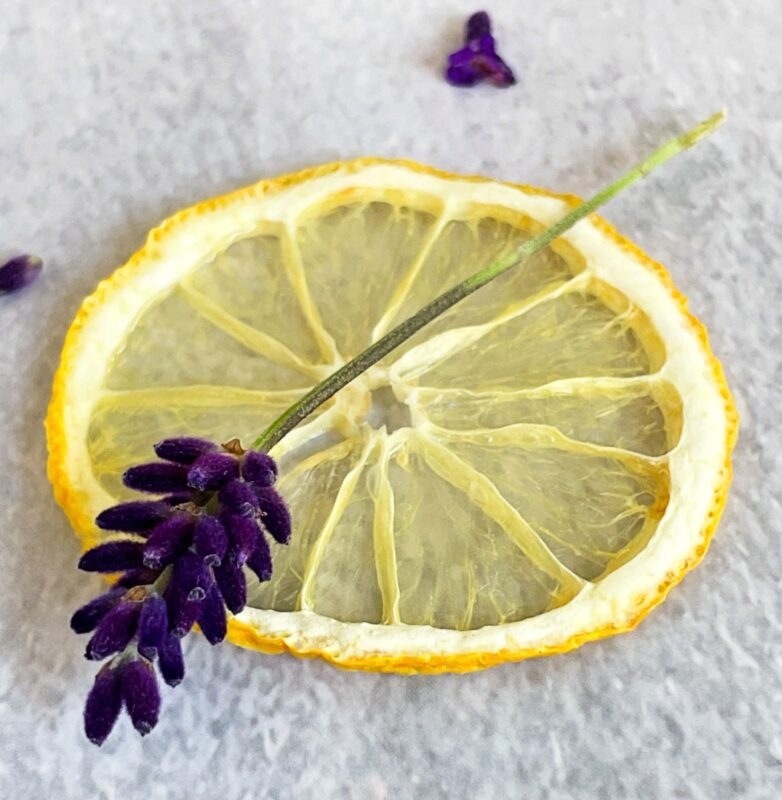 a dehydrated lemon slice and a fresh lavender sprig