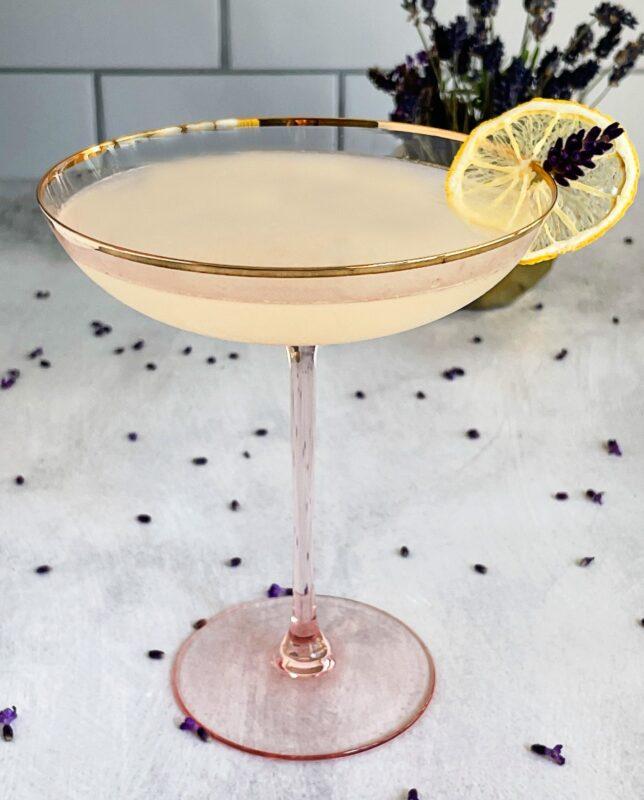 lavender lemon drop cocktail with a dehydrated lemon peel garnish