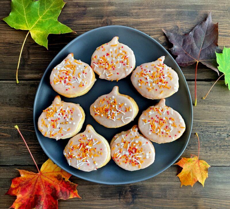 pumpkin spice donuts with sprinkles on a plate
